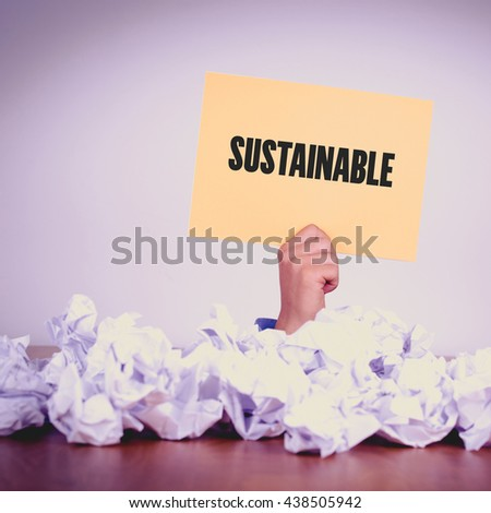 HAND HOLDING YELLOW PAPER WITH SUSTAINABLECONCEPT - stock photo