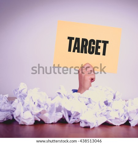 HAND HOLDING YELLOW PAPER WITH TARGETCONCEPT - stock photo