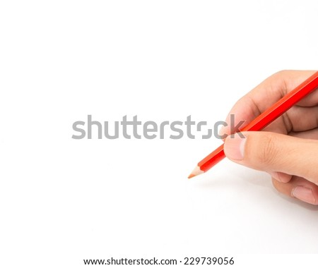 Hand holds a color pencil with white background for text. - stock photo