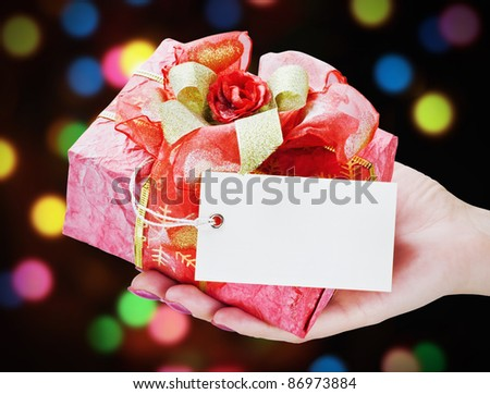 hand holds a gift - stock photo