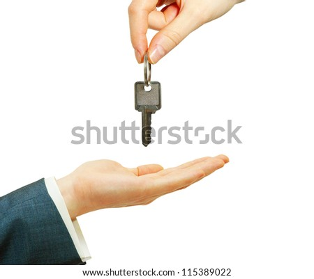 hand holds a key isolated on white - stock photo