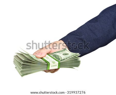 Hand holds a pack of dollars on blue background. Take the money.