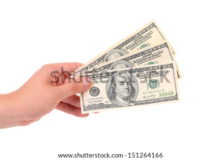 Hand holds american Dollar-bills