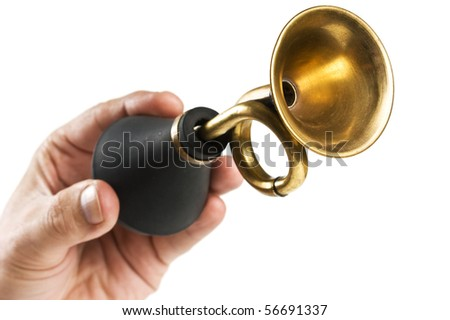 hand holds an old car horn  isolated on a white background