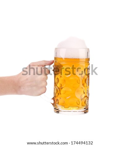 Hand holds big mug with gold beer. Isolated on a white background. - stock photo