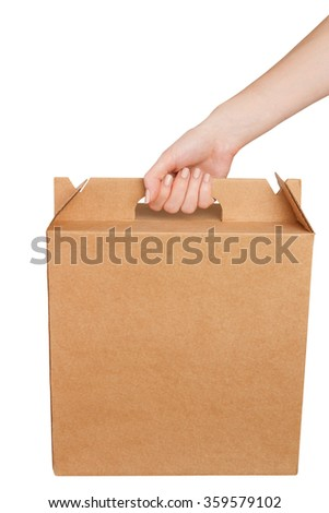 Hand holds cardboard box isolated on white background - stock photo