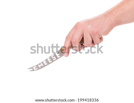 Hand holds cheese knife. Isolated on a white background.
