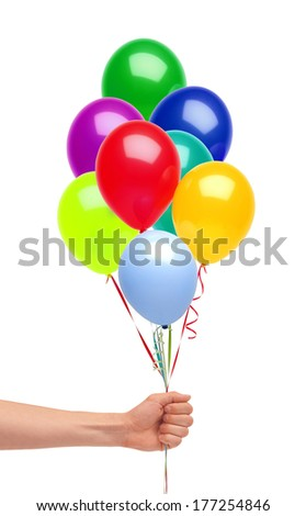 Hand holds colorful balloons isolated on white background
