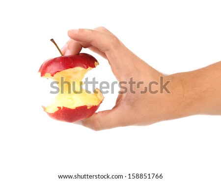 Hand holds core of an apple. Close up - stock photo