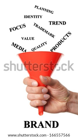 hand holds funnels by fall into words that are necessary for branding