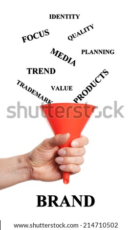 hand holds funnels by fall into words that are necessary for branding - stock photo