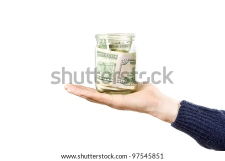hand holds glass jar with the money isolated on white background - stock photo