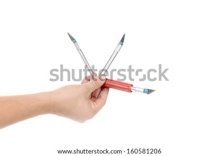 Hand holds of Craft Knifes on a white background - stock photo