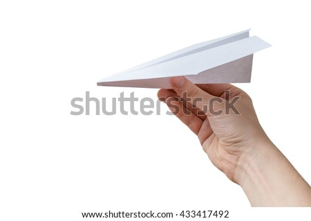 Hand holds origami paper airplane. Isolated on white background. - stock photo