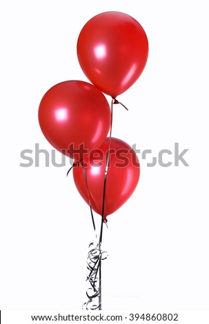 Hand holds red balloons isolated on white