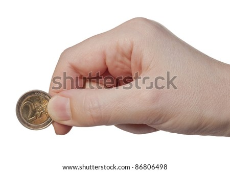 Hand holds the coin 2 euros, isolated on a white background - stock photo