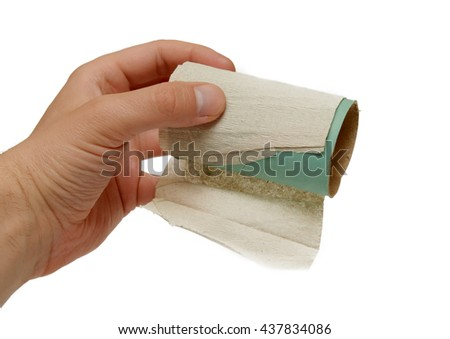 Hand holds the core of toilet paper on a white background