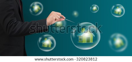hand hole needle with house in the bubble - stock photo