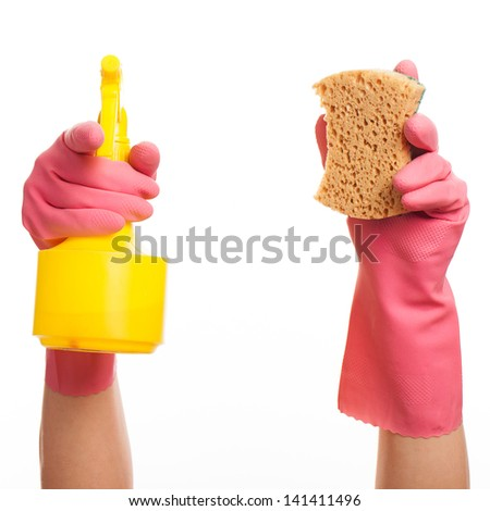 Hand in a pink glove holding spray bottle and sponge isolated over white background - stock photo