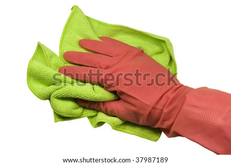 Hand in a pink rubber glove and a green rag. On a white background - stock photo