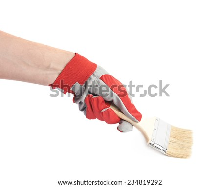 Hand in a red working glove holding a paint brush, composition isolated over the white background