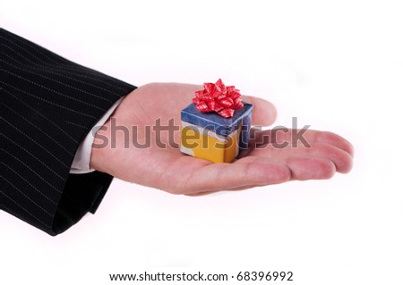 Hand in a suit giving a gift