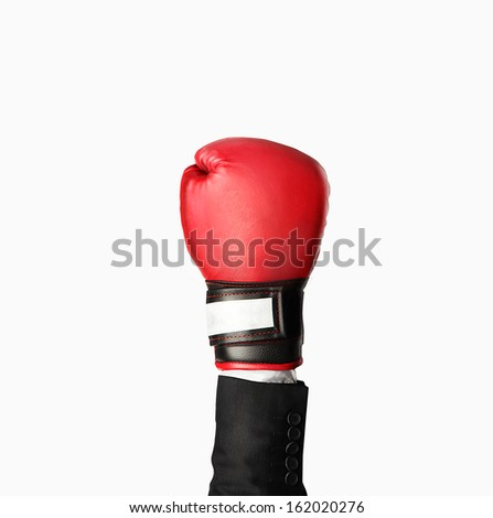 hand in boxing gloves isolated on gray - stock photo