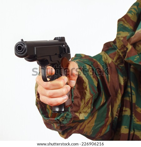 Hand in camouflage uniform with army handgun on a white background - stock photo
