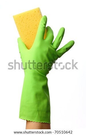 Hand in glove holding washing sponge, isolated over white