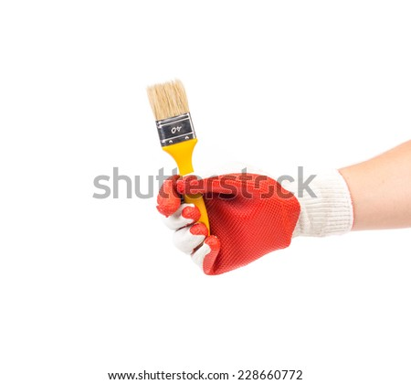 Hand in gloves holds brush. Isolated on a white background.