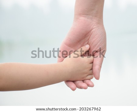 hand in hand,small hand in big hand - stock photo