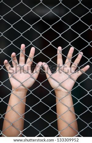 hand in jail. - stock photo