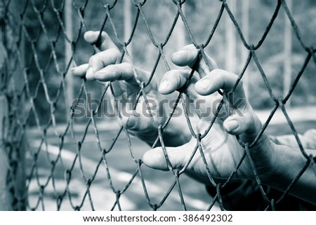 hand in jail ,retro tone - stock photo