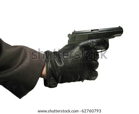 Hand in leather gloves with gun