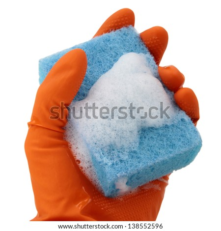 Hand in orange glove with sponge isolated on white background - stock photo