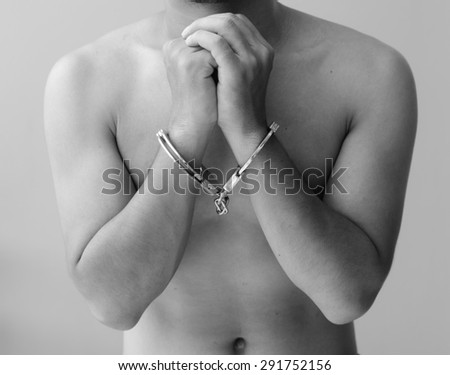 hand in shackle - stock photo
