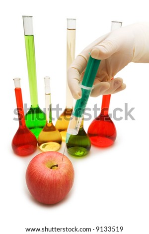 Hand injecting chemical into apple isolated on white - stock photo