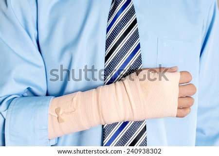 Hand injured businessman, insurance concept - stock photo