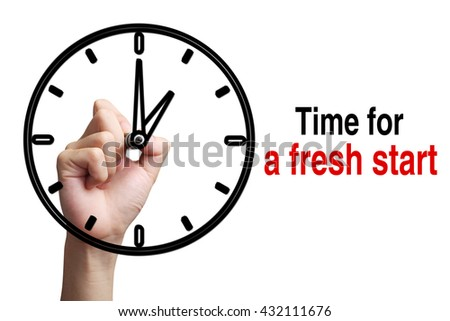 Hand is drawing a clock with text Time For a Fresh Start Concept aside isolated on white background. - stock photo