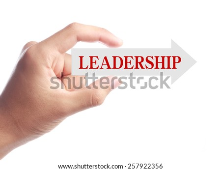 Hand is holding Leadership arrow isolated on white background. - stock photo