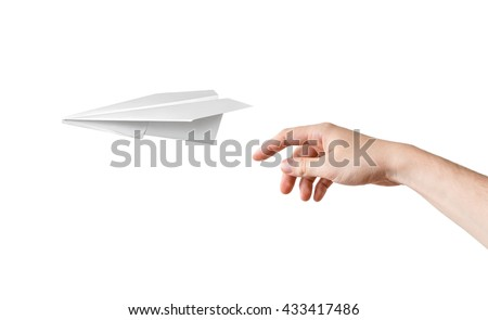 Hand is throwing origami paper airplane. Isolated on white background. - stock photo