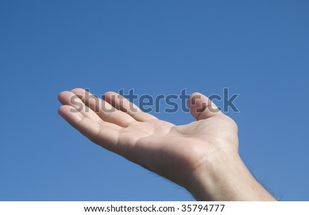 Hand isolated on a blue background