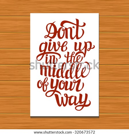 Hand lettering typography poster on wooden background.Motivational quote 'Don't give up in the middle of your way'.For posters, cards, home decorations.Raster copy - stock photo