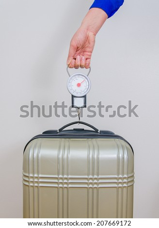Hand luggage measurement using steelyard balance. - stock photo
