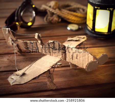 hand made children airplane on wood table - stock photo