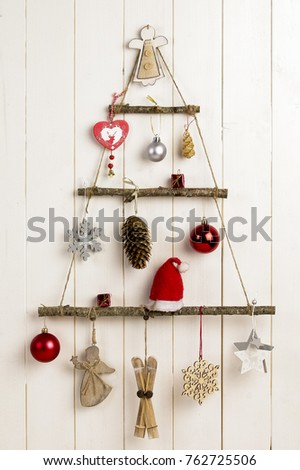 hand made christmas wall decoration on a white wooden wall