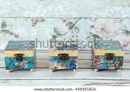 Hand made decoupage jewellery boxes on a shabby chic background - stock photo