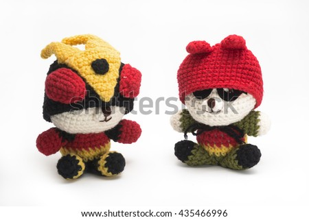 hand made  dolls from knitting wool on white  background