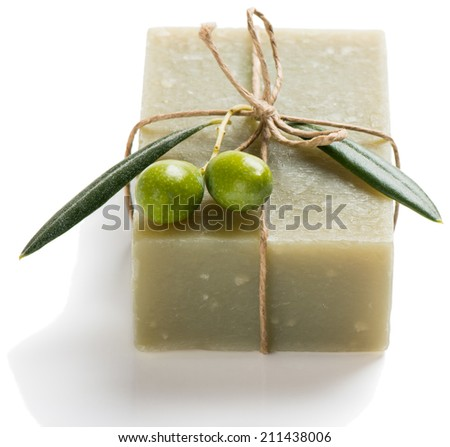 Hand-made olive soap with branch of olive tree and fruits isolated on white - stock photo