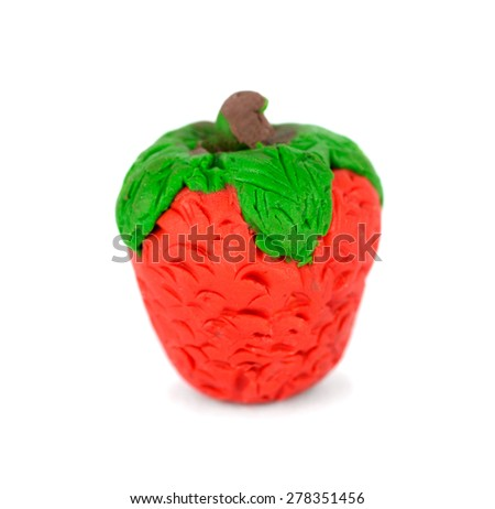 Hand made plasticine or modeling clay figure of a strawberry on white background - stock photo